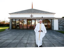 Father Storey outside the church