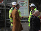 Charles chats with builders