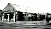 Tonkins Garage with Three Pumps Outside